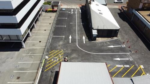 Aerial of commercial roadway and carpark